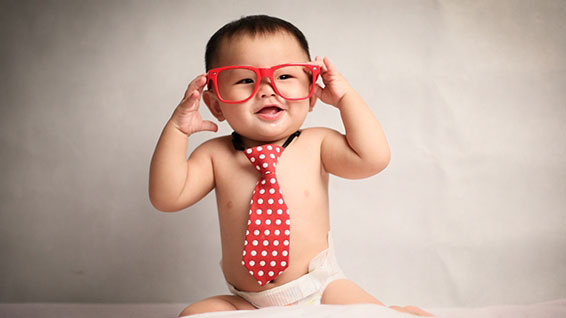 Baby with spectacles on face