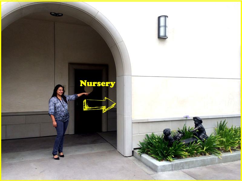 Photo of woman pointing to the nursery entrance
